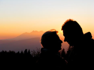 Elderly couple sunset