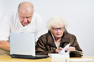 Elderly couple at desk