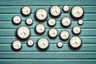 Many-clocks-in-a-blue-wooden-background