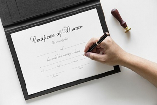 A-hand-writing-on-the-certificate-of-divorce