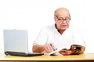 Elderly man researching