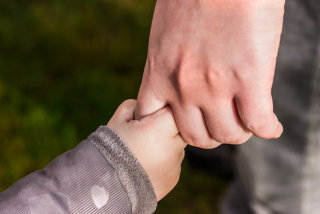 Canva-child-holding-hand-of-another-person-MADGxs6iF9U