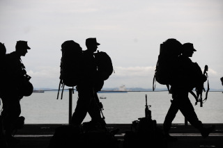 Canva-line-of-soldiers-walkin-MADGxxLKCBk
