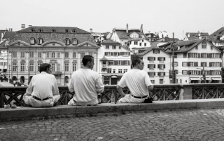 Canva-black-and-white-picture-of-three-man-sitting--MABLeYbmmvQ
