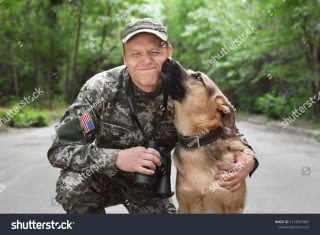Stock-photo-man-in-military-uniform-with-german-shepherd-dog-outdoors-1114507862