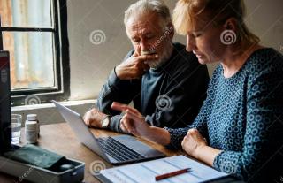 Elderly-couple-planning-life-insurance-plan-elderly-couple-planning-life-insurance-plan-99197910